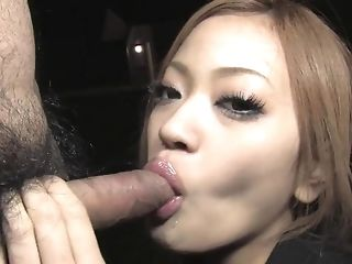 Sweet japanese woman deep-throats a massive pretentious meatpipe in the dark porn tube