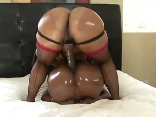 Dark-hued lesbos with elastic asses consequently line cock playthings in couch sextube