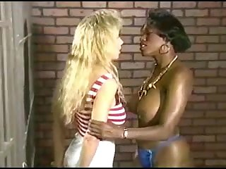 Ebony lezzie prisoner with huge globes tempts youthful buxomy ash-blonde in jail