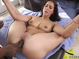 A dark-hued stud is thrusting his imposingly hard-on deep in his puny brunette's cock-squeezing cunny